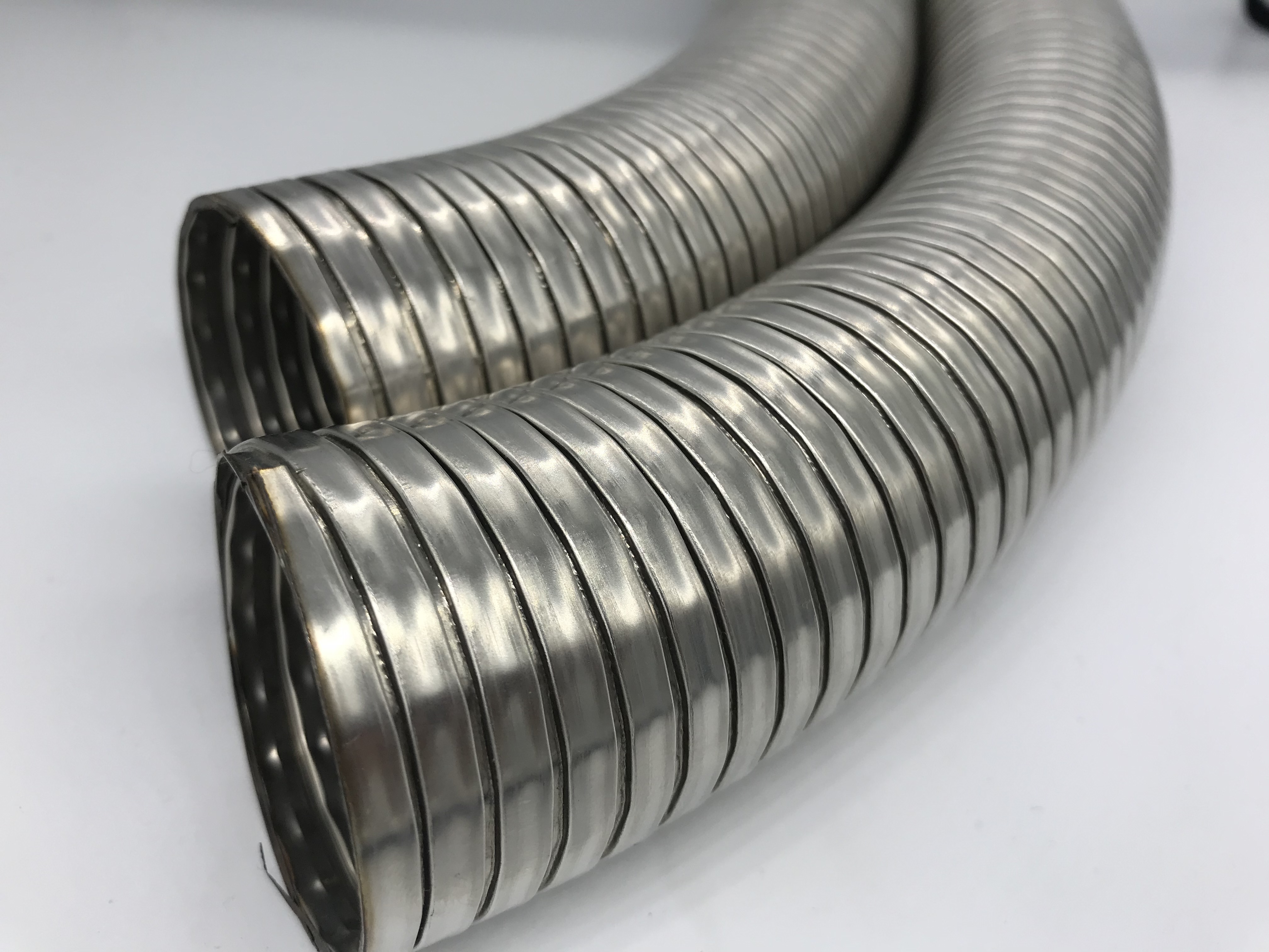Flexible interlocked Stainless steel welded hose with extension Slotted pipe